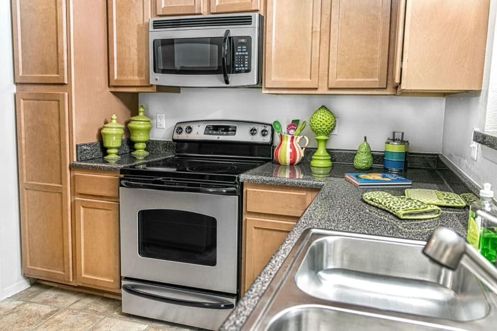 Kitchen with stainless steel appliances at The Views at Laurel Lakes in Laurel, Maryland