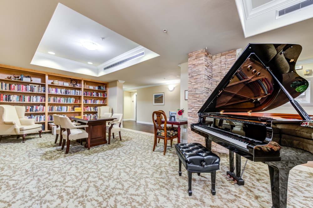 Library with a piano at Cypress Place, Ventura in CA