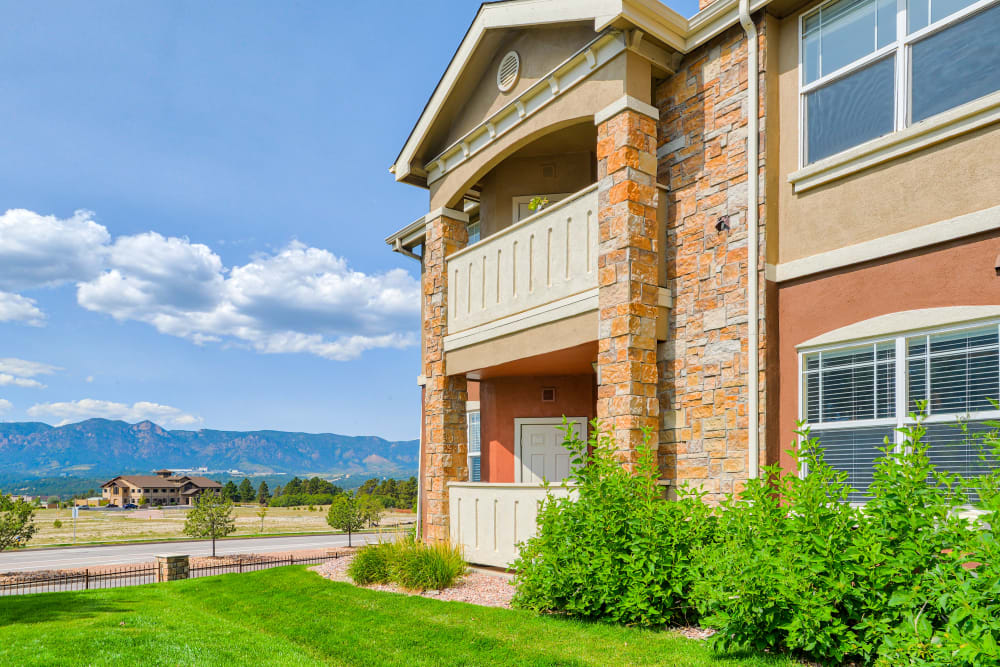 Exterior with mountainous background at Bella Springs Apartments in Colorado Springs, Colorado