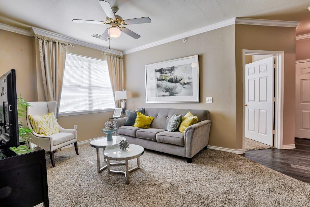 Living room with large windows at Bella Springs Apartments in Colorado Springs, Colorado
