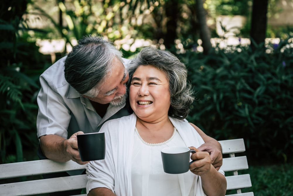 Resident couple enjoys a cup of coffee outside at Arlington Place of Grundy Center in Grundy Center, Iowa
