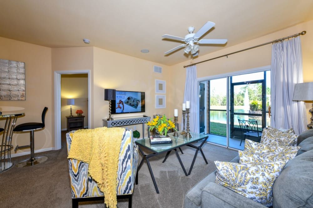Living room with a ceiling fan at Courtney Isles in Yulee, Florida