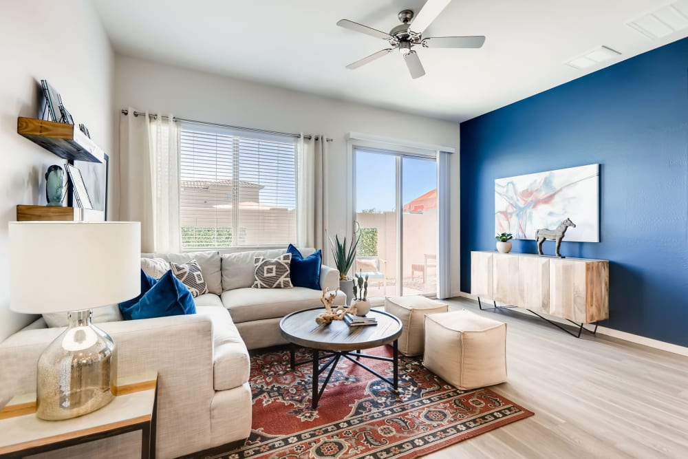 Living room with lots of natural lighting at Avilla Lago in Peoria, Arizona