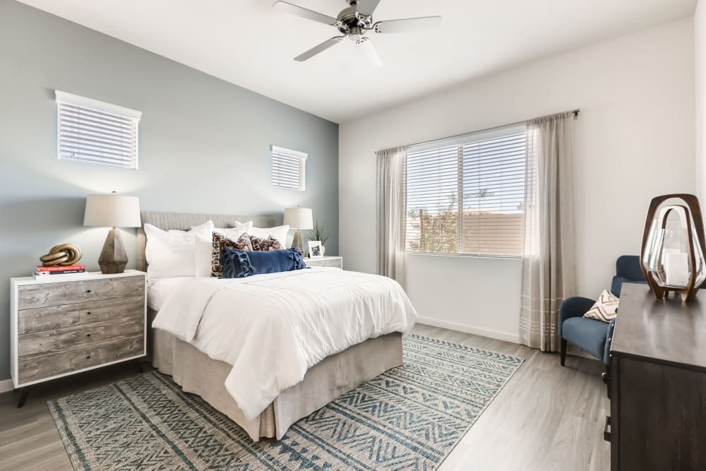 A master bedroom with lots of space at Avilla Lago in Peoria, Arizona