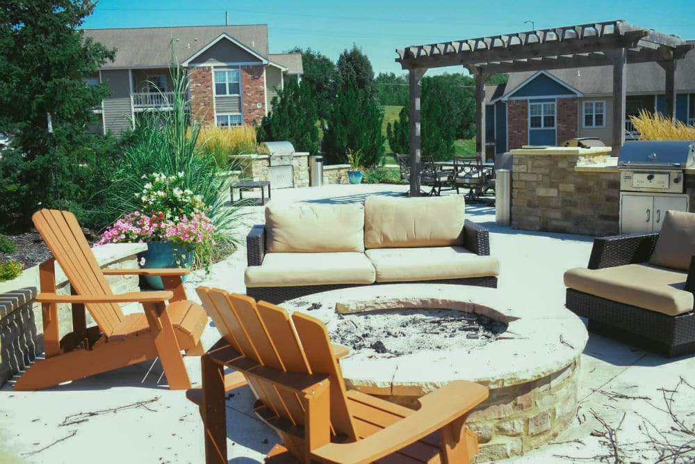 Outdoor fireplace with seating at Aberdeen Apartments in Lawrence, Kansas