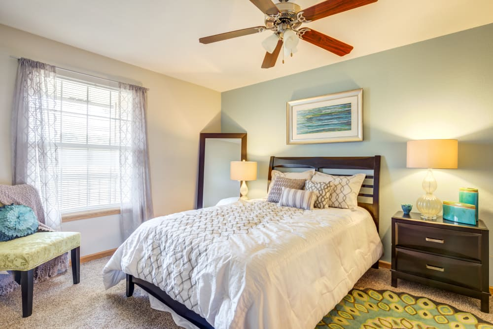 Beautiful bedroom with lots of natural lighting at Aberdeen Apartments in Lawrence, Kansas