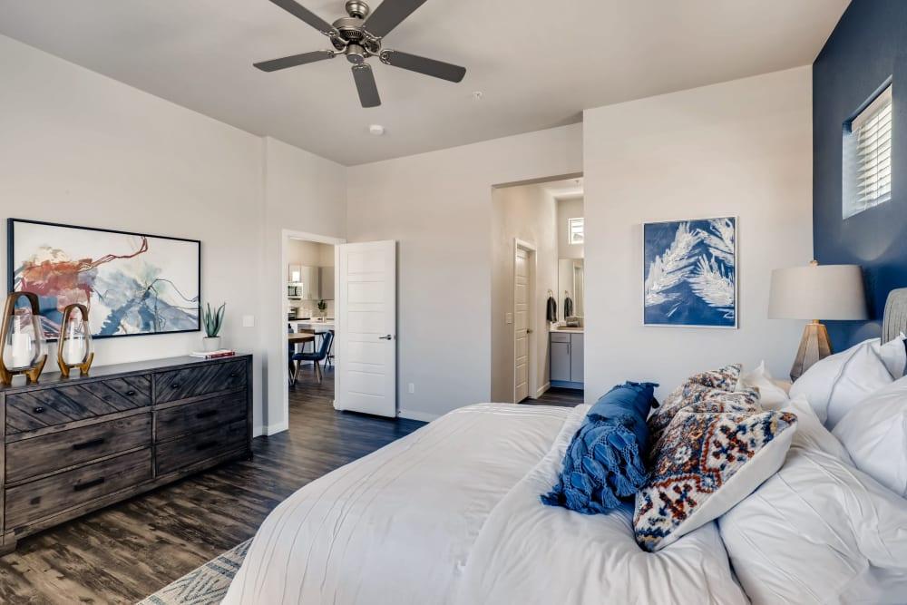 A spacious master bedroom with a modern bathroom at Avilla Eastlake in Thornton, Colorado