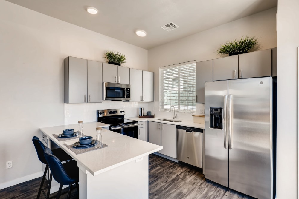 A modern kitchen with stainless-steel appliances at Avilla Eastlake in Thornton, Colorado