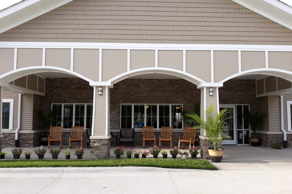 Outdoor porch with rocking chairs at Country Meadow Place in Mason City, Iowa