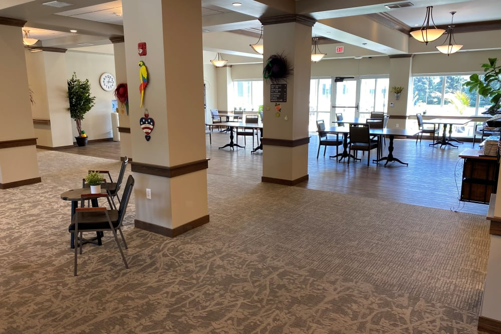 Brightly lit foyer with tables at Country Meadow Place in Mason City, Iowa