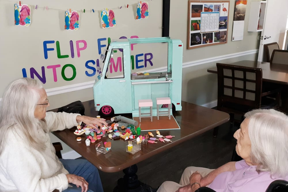Residents play memory games to sharpen their skills at Corridor Crossing Place in Cedar Rapids, Iowa