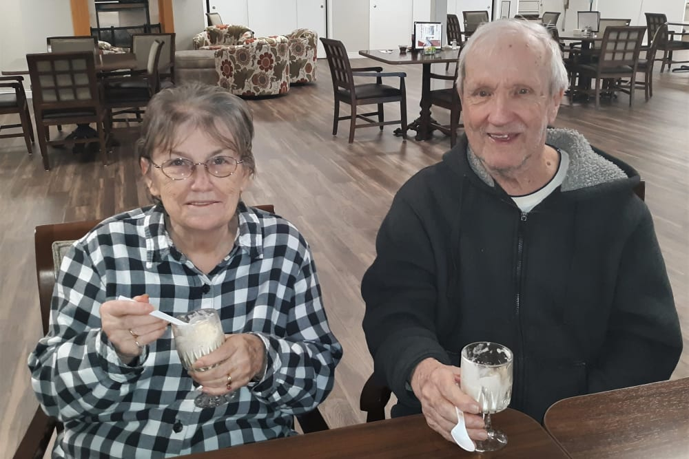 Resident couple have snacks and beverages at Corridor Crossing Place in Cedar Rapids, Iowa