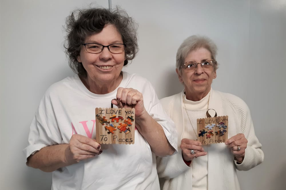 Two residents show their arts and craft project at Corridor Crossing Place in Cedar Rapids, Iowa