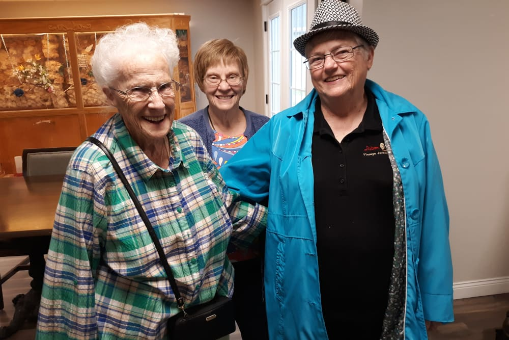 Three residents pose for the camera at Corridor Crossing Place in Cedar Rapids, Iowa