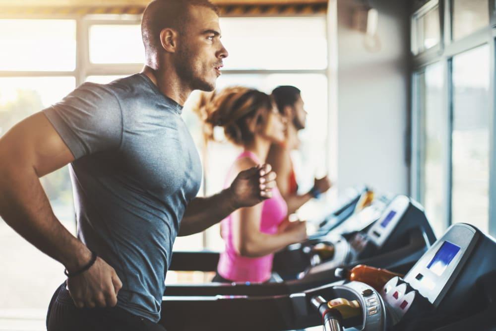 Resident running on a treadmill at Gramercy Scottsdale in Scottsdale, Arizona