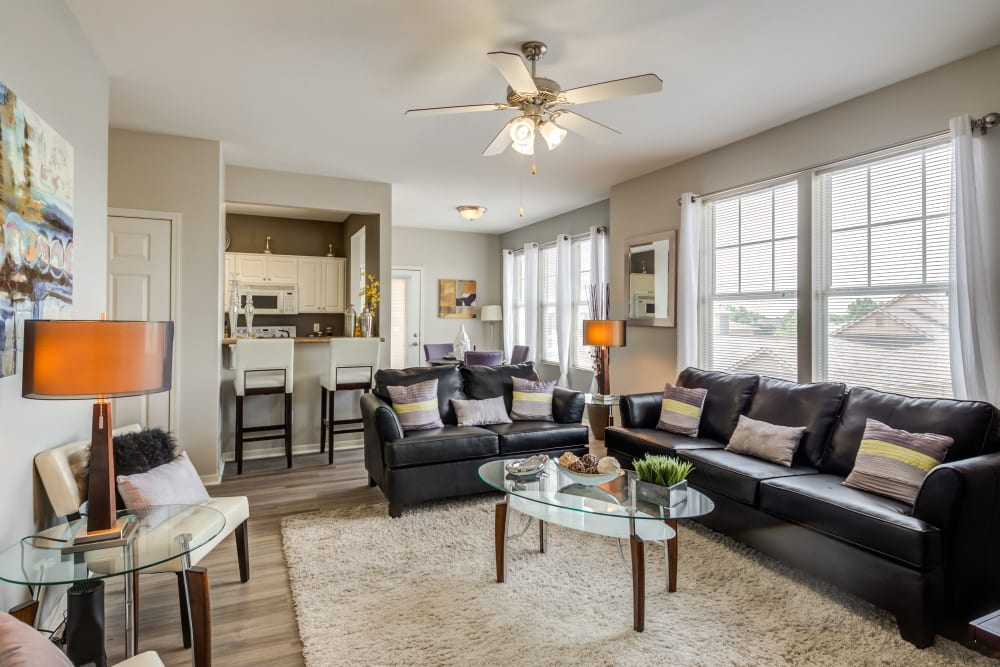 A spacious and open living room with large windows at Alvadora Apartments in Lawrence, Kansas