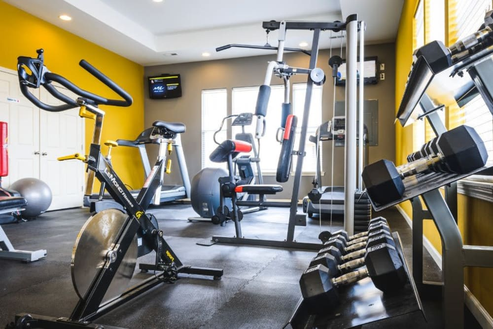 Fitness center with individual workout stations at Alvadora Apartments in Lawrence, Kansas