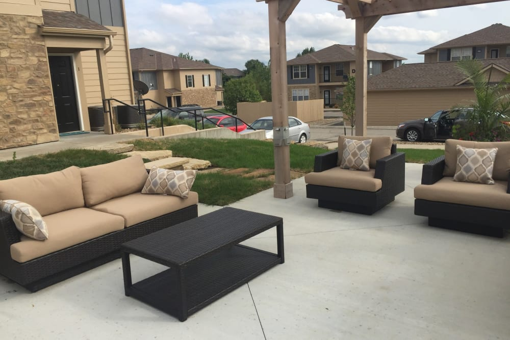 A comfortable, outdoor community lounge at Alvadora Apartments in Lawrence, Kansas