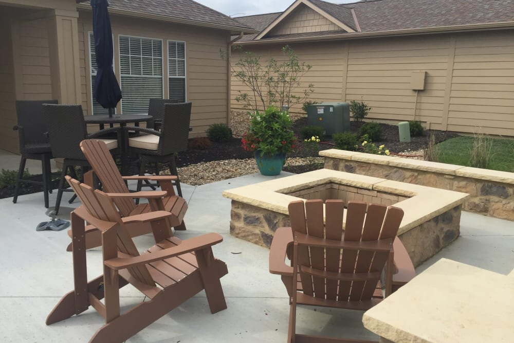 Firepit surrounded by comfortable seating on a nice summer night at Alvadora Apartments in Lawrence, Kansas