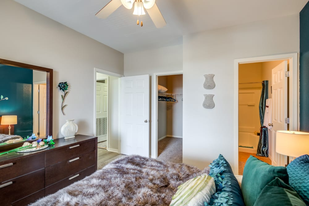 The main bedroom with a large bathroom at Alvadora Apartments in Lawrence, Kansas