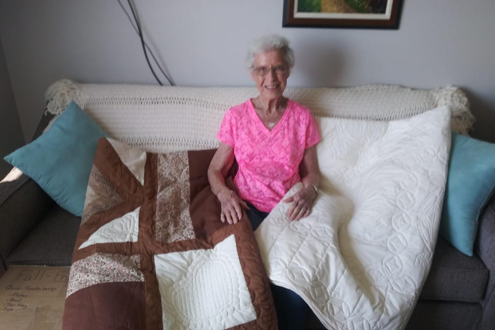 A resident shows us the quilts she made at Arlington Place of Red Oak in Red Oak, Iowa