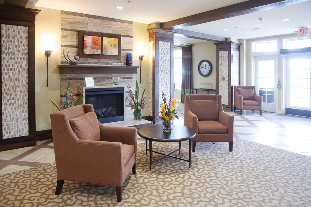 Lounge with a fireplace at Legacy at Bear Creek in Keller, Texas.