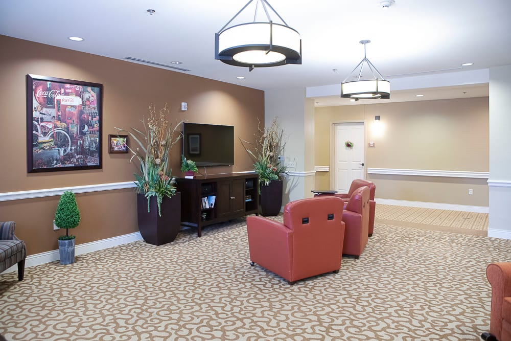 community room with a TV at Legacy at Bear Creek in Keller, Texas.