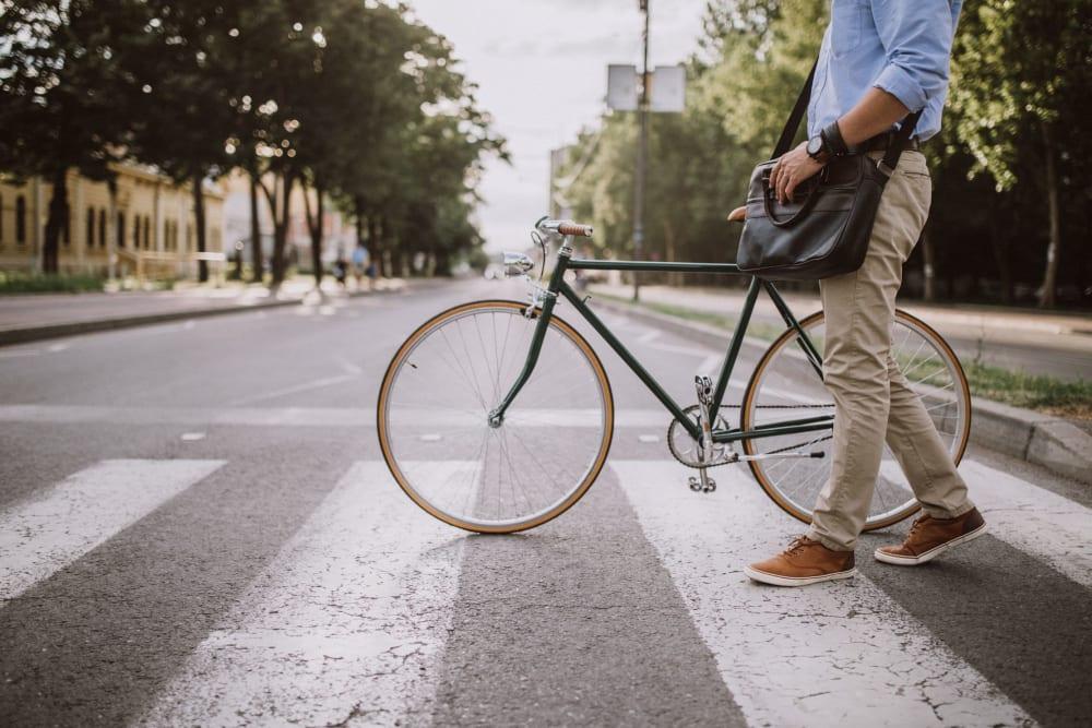 Resident crossing the street with his bike near 17th Street Lofts in Atlanta, Georgia