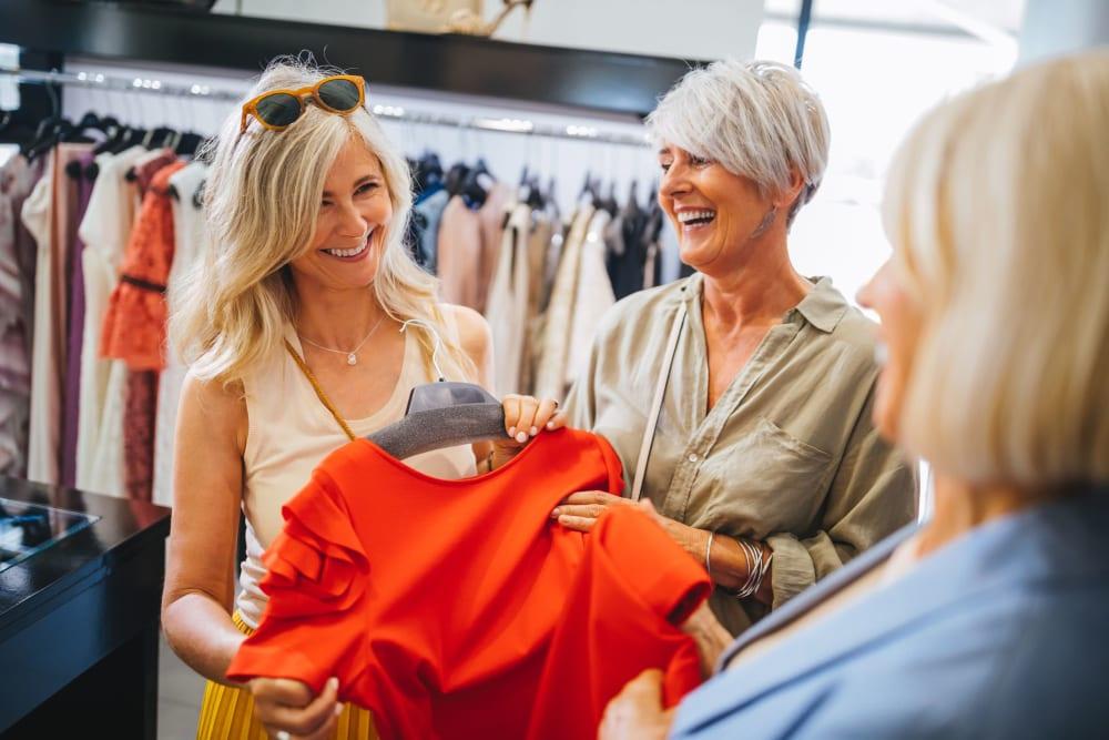 Friends clothes shopping together in Atlanta, Georgia near 17th Street Lofts