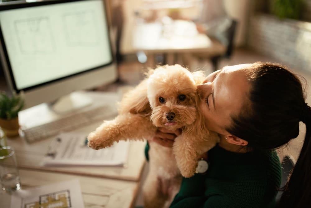 Resident hugging her dog at 17th Street Lofts in Atlanta, Georgia