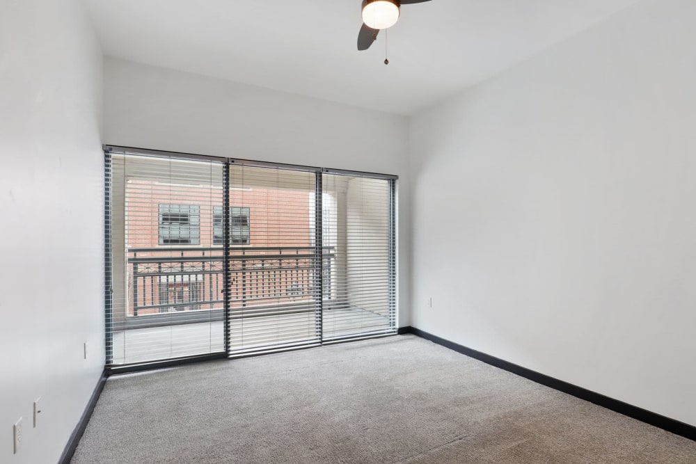Spacious bedroom with patio access at 17th Street Lofts in Atlanta, Georgia