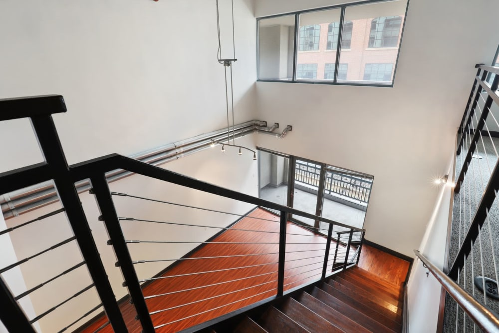 Stairs down to the first floor at 17th Street Lofts in Atlanta, Georgia