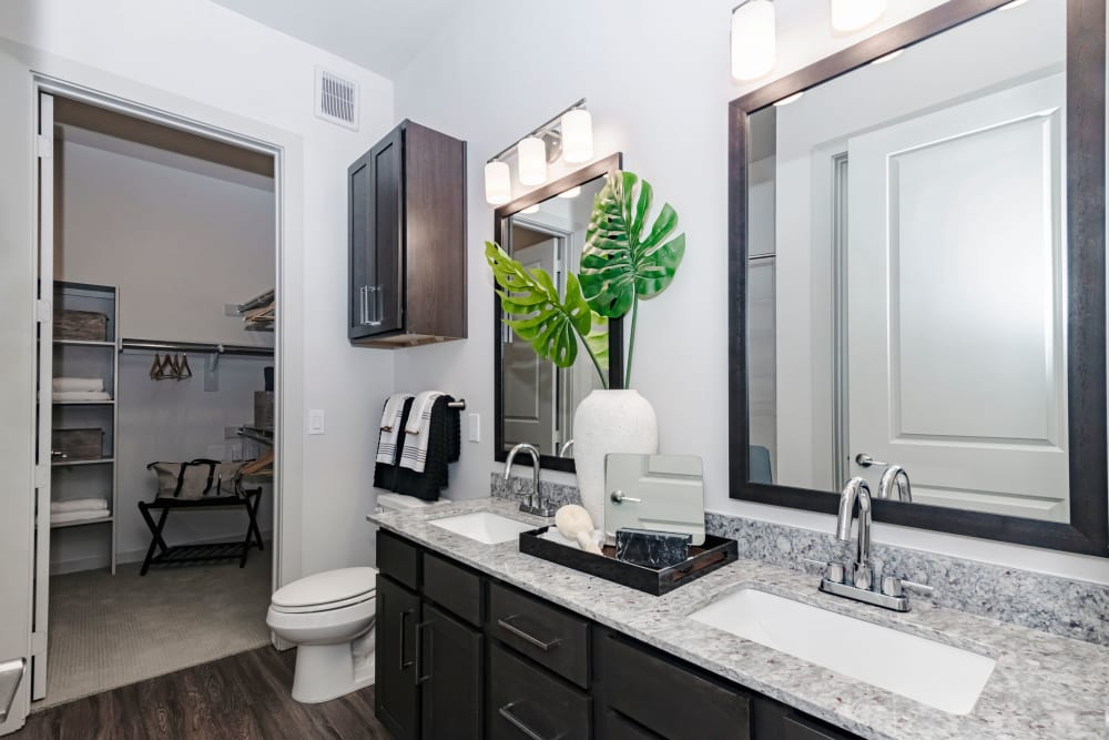 Spacious clean bathroom with a walk-in closet at Magnolia on the Green in Allen, Texas