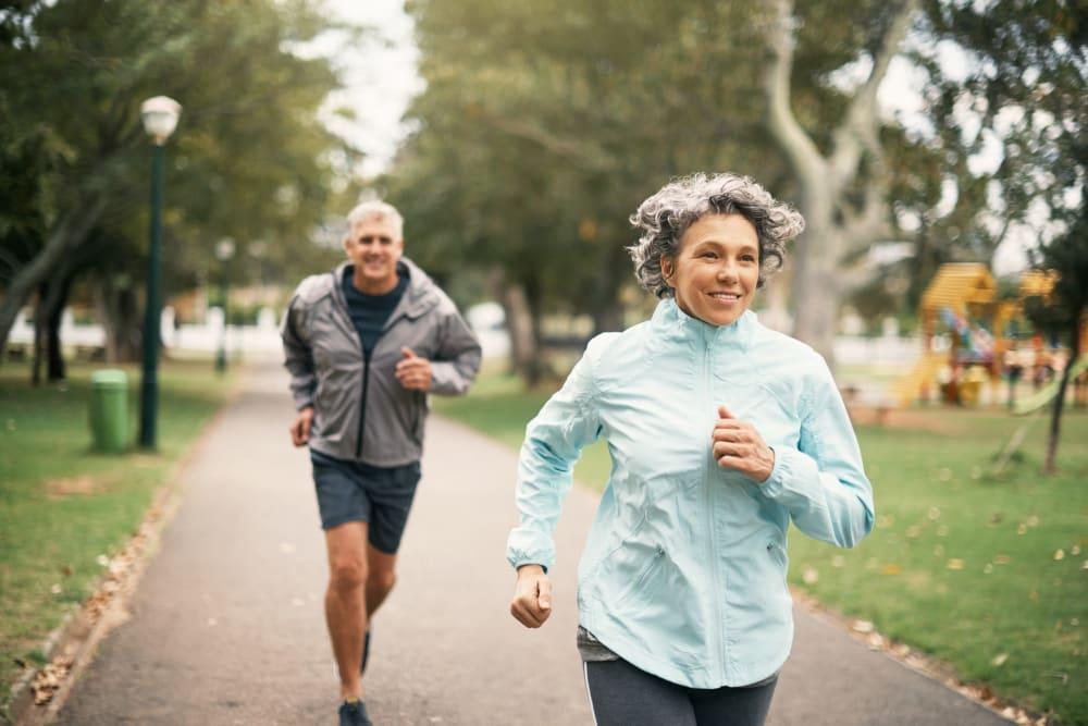 Couple jogging near Golden Pond Retirement Community in Sacramento, California