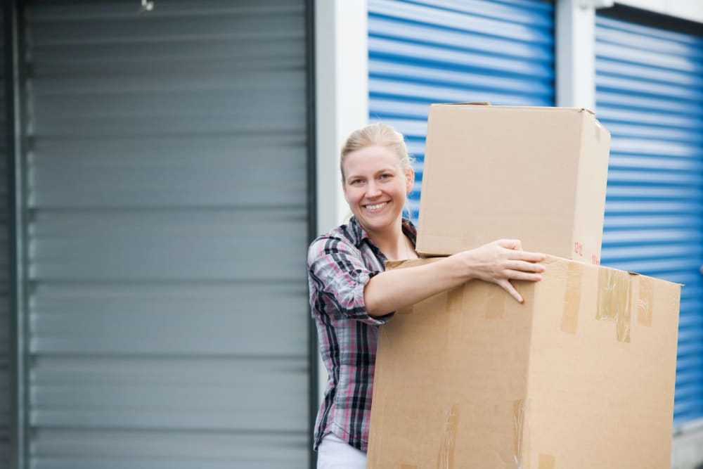 A women moving boxes out of a storage unit at StayLock Storage in Athens, Georgia