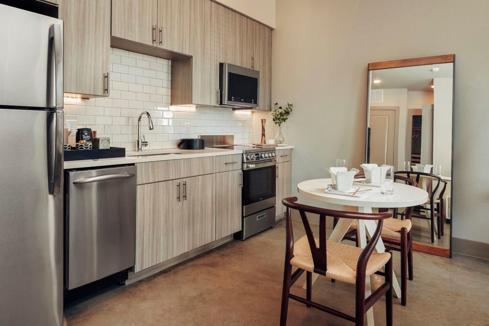Stainless-steel appliances in a model home's kitchen at The Guthrie in Austin, Texas