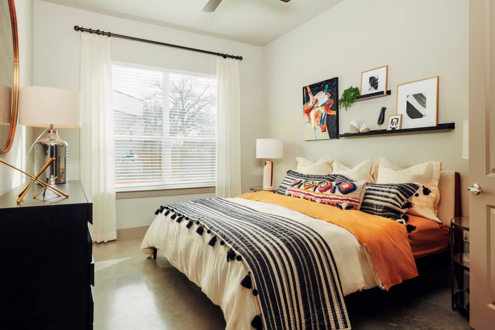 Large bay window in a model home's bedroom at The Guthrie in Austin, Texas