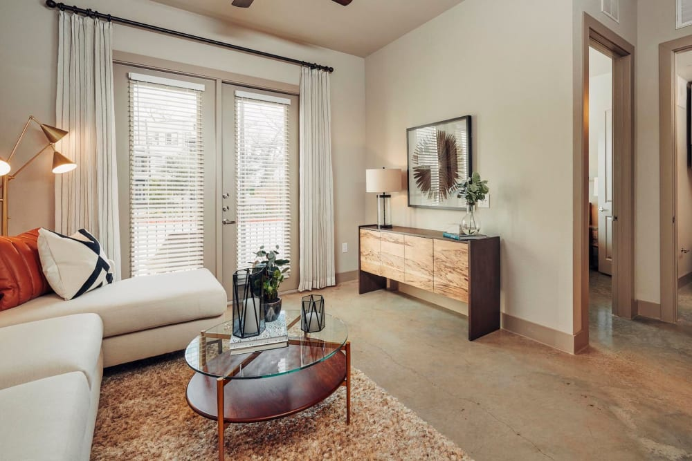 Comfortably furnished living area in a model home at The Guthrie in Austin, Texas