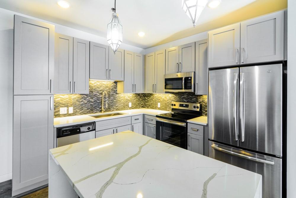 Kitchen with stainless steel appliances at Steelyard in St. Louis, Missouri