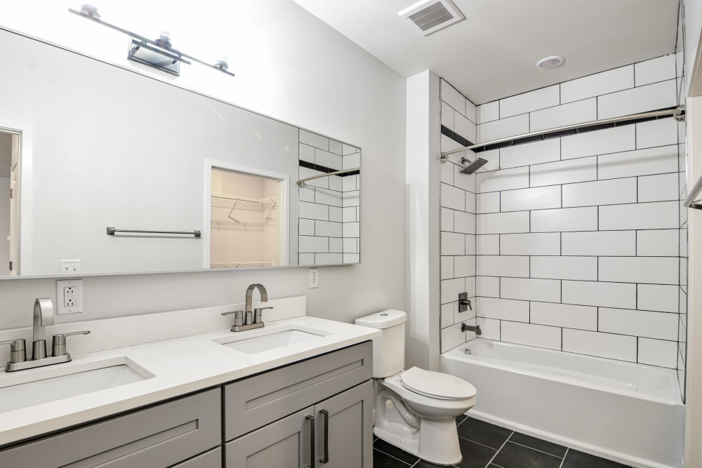 Bathroom with subway tile at Steelyard in St. Louis, Missouri