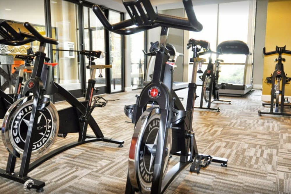 A fitness center with spin bikes at Goldelm at Metropolitan in Knoxville, Tennessee