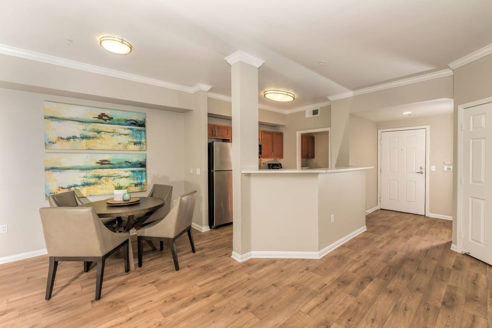 Dining room table and kitchen at Avion Apartments in Rancho Cordova, California