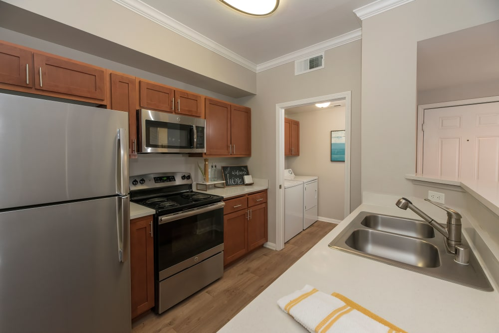 Kitchen with wood-style flooring and stainless steel appliances at Avion Apartments in Rancho Cordova, California