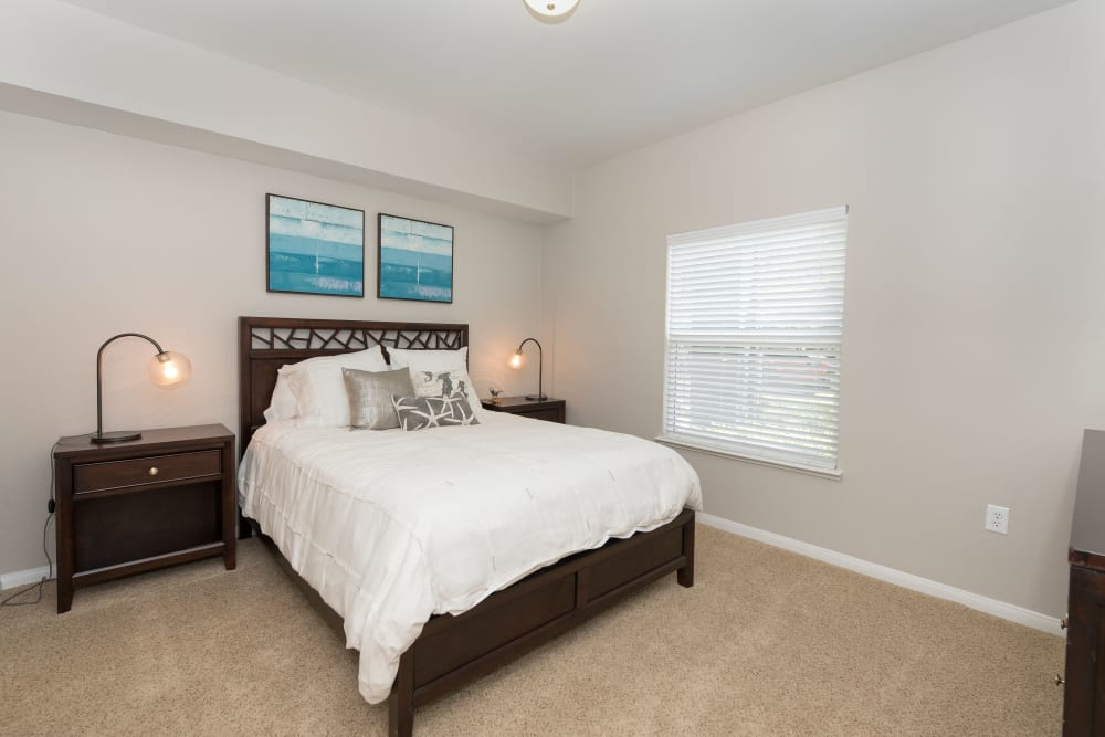 Large bedroom with a ceiling fan at Avion Apartments in Rancho Cordova, California