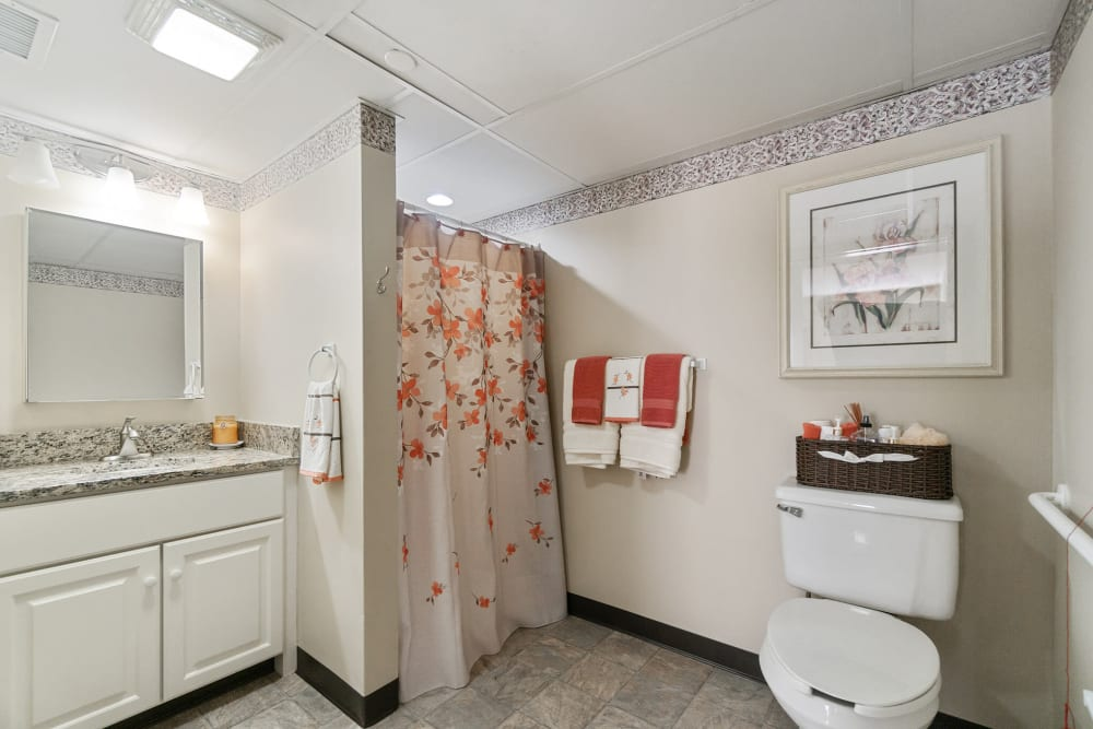 Senior apartment bathroom with a walk in shower at The Hearth at Gardenside in Branford, Connecticut