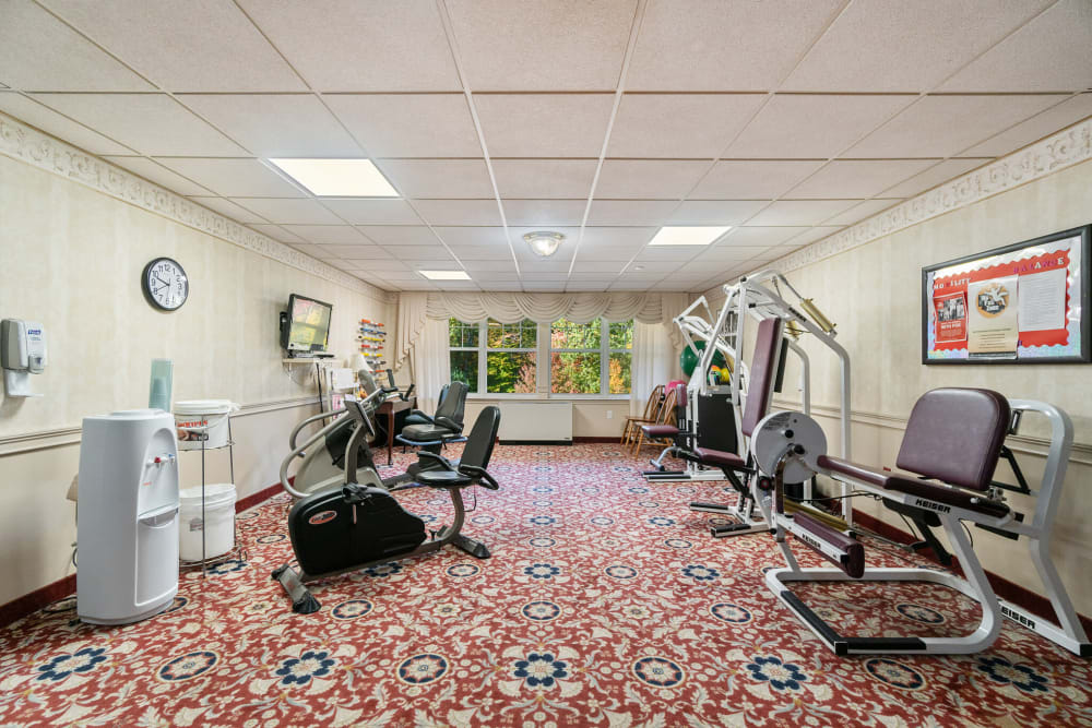 Exercise room with various equipment at The Hearth at Gardenside in Branford, Connecticut