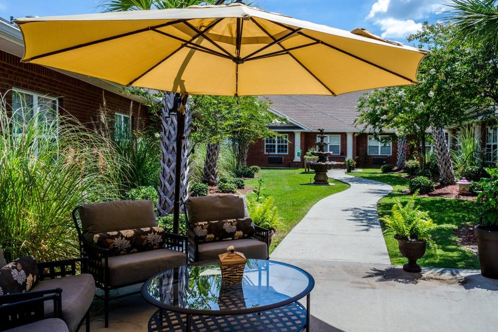 Outdoor dining at Truewood by Merrill, Ocean Springs in Ocean Springs, Mississippi.