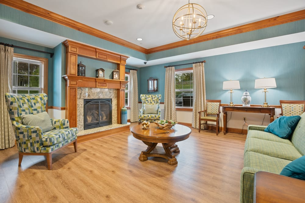 Lounge area with hardwood floors and a fireplace at The Hearth at Hendersonville in Hendersonville, Tennessee
