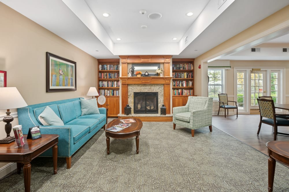 Carpeted area of a lounge with a fireplace at The Hearth at Hendersonville in Hendersonville, Tennessee