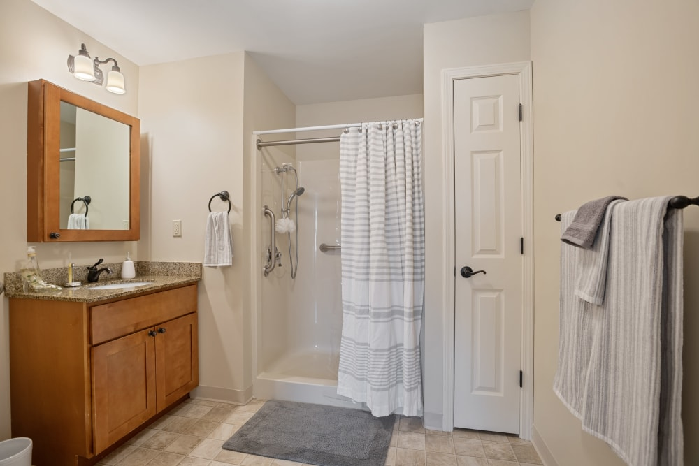 Bathroom with a standing shower in an apartment at The Hearth at Hendersonville in Hendersonville, Tennessee